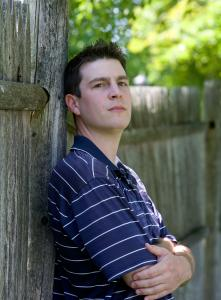 Daniel St. Pierre, 26, a 2009 college graduate and now a sports blogger, outside his Amesbury house, which he and his girlfriend, an accountant, live frugally to pay for.