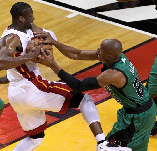 Ray Allen&#8217;s defense on driving Heat star Dwyane Wade earned the Celtics a jump ball in the first quarter of Game 1 Monday night.