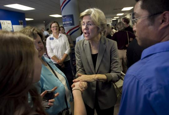 Elizabeth Warren, at her Somerville headquarters Thursday, e-mailed supporters to explain her handling of ancestry questions.