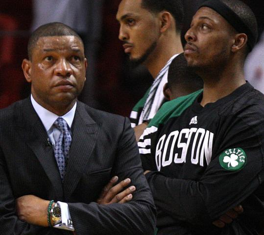 Celtics coach Doc Rivers and captain Paul Pierce could do very little as time wound down in Boston's Game 2 overtime loss in Miami.