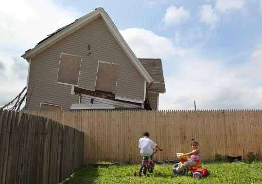 Springfield's Six Corners neighborhood, plagued by foreclosures before the tornado, has been slow to recover.