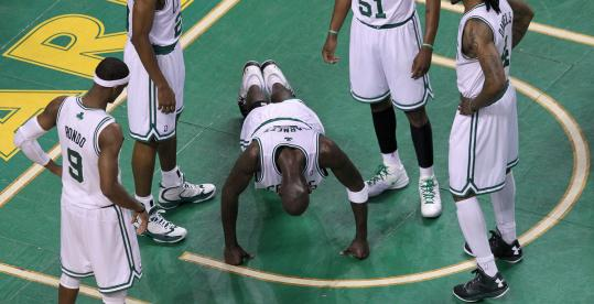 The Celtics' Kevin Garnett was showing some power moves after getting knocked to the floor while battling for a rebound in the first half of Game 3.