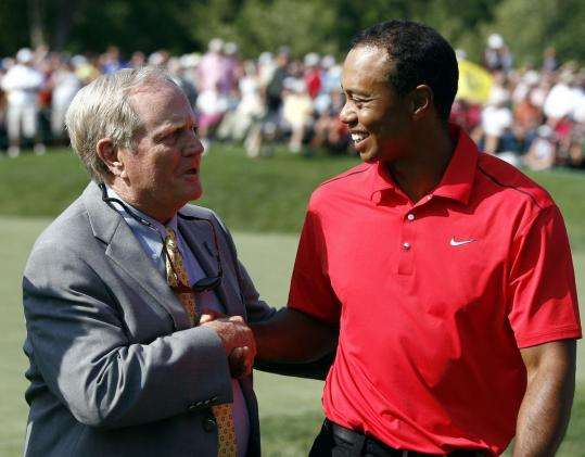 Tiger Woods is greeted by Jack Nicklaus, whom he tied with his 73d PGA Tour win.