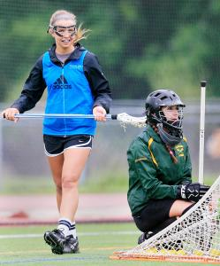 Wayland High sophomore scorer Amy Cunningham (left) and senior goalie Rachel Massicotte, taking a break during a recent practice, are among the team&#8217;s leaders this spring.