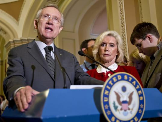 Senate majority leader Harry Reid, accompanied by Lilly Ledbetter, right, the woman who has become the symbol for the workplace equality movement, and advocates said wider protections were necessary.