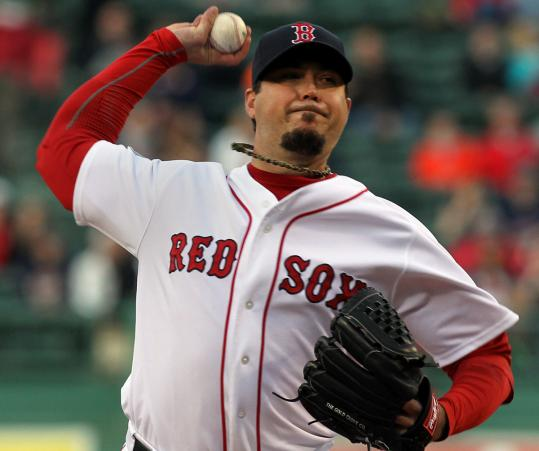 Josh Beckett throws in the first inning. He worked eight innings overall, giving up only two runs, but took the loss.