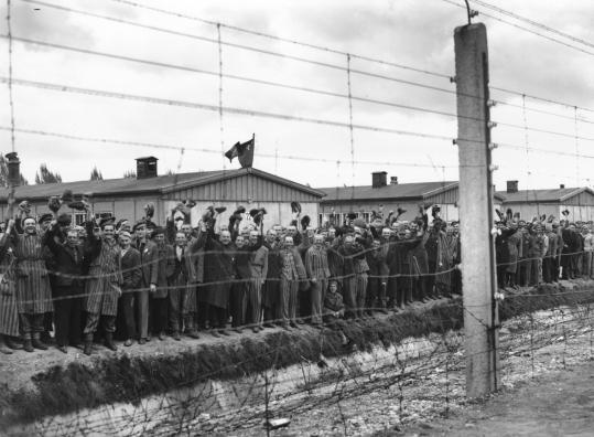 Prisoners at Dachau cheer US troops who liberated the concentration camp in May 1945. Researchers are finding that the passage of time does not always diminish traumatic symptoms &#8212; and old age can actually aggravate them.