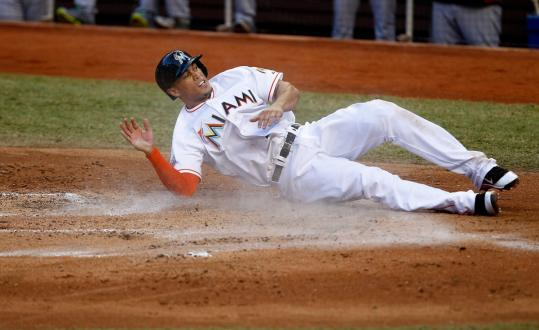 Mike Stanton did some dirty work for the Marlins in the first inning by sliding in safely with the team's second run, scoring on a double and an error by Red Sox right fielder Adrian Gonzalez.