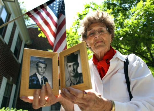 Alice DelRossi holds photos of her brother, Richard Fitzgibbon (right), and his son, Richard III, both of whom died during the Vietnam War.