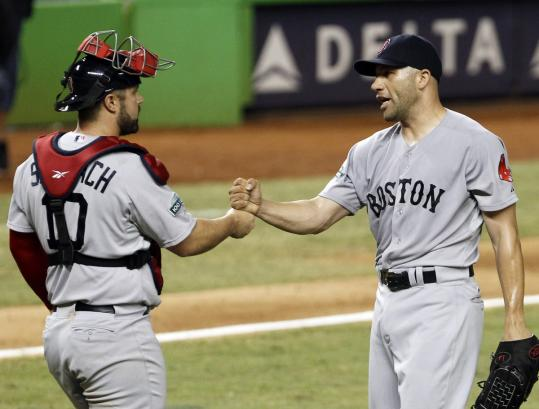 Alfredo Aceves hooked up with catcher Kelly Shoppach after he shut down the Marlins in the ninth for his 15th save.