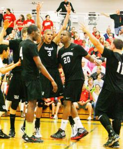 Cambridge beat Milford in the boys state volleyball championship, 3-2. Cambridge players celebrated the win.