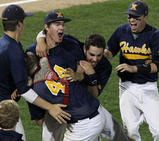 Xaverian pitcher Alex Person (second from left) celebrates with his teammates after their title win over Algonquin.