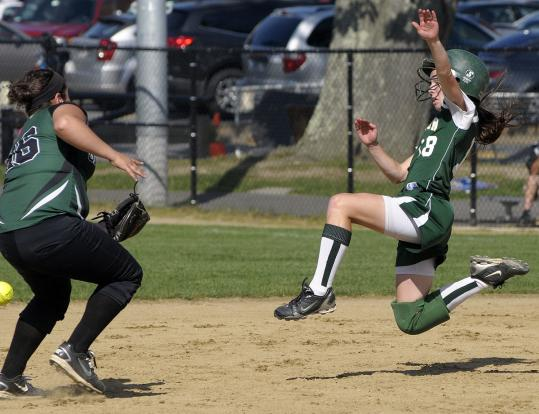 Abington's Alicia Reid is safe after stealing second as the throw from home gets by Grafton shortstop Marissa Ruggiero, but the Green Wave was held scoreless.