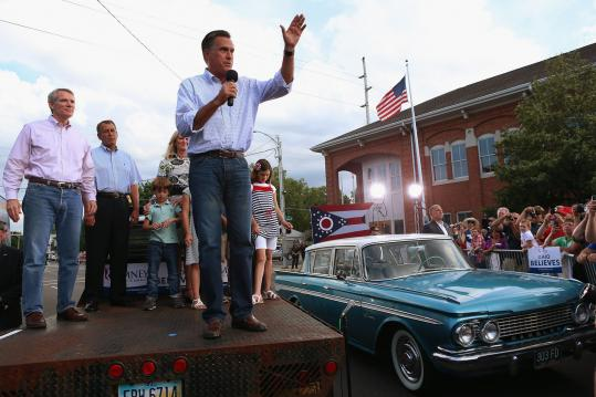 Mitt Romney gave a speech in Troy, Ohio, where a group of protesters shouted throughout his address.