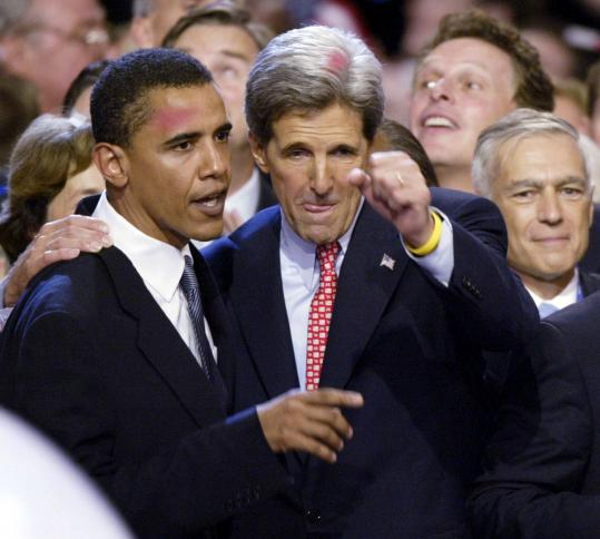 Democratic presidential candidate John Kerry is joined by US Senate candidate Barack Obama on July 29, 2004, at the closing of the Democratic National Convention in Boston. Kerry will now play the role of the presumptive Republican presidential nominee, former Massachusetts Governor Mitt Romney, in President Obama&#8217;s debate preparation sessions.