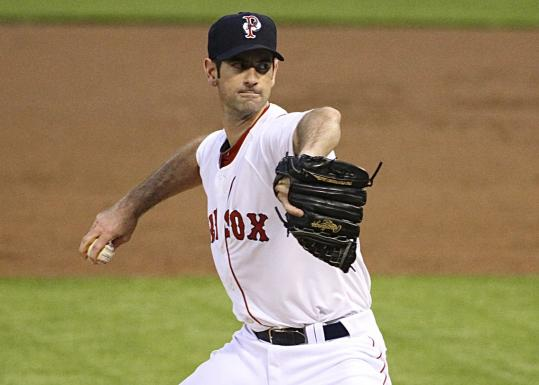 Battling his way back to the majors, former Cubs ace Mark Prior delivers a pitch for the Pawtucket Red Sox.