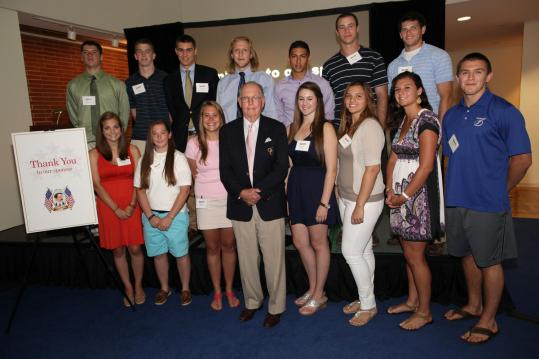 This year's Globe Scholar-Athletes gather around Richard Phelps, a benefactor of the scholarship program.