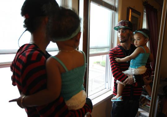 Cristian Morales held his daughter, 2-year-old Jade, at their Malden home. He is 19 and received aid through the Summit for Teen Empowerment, Progress, and Parenting Success.