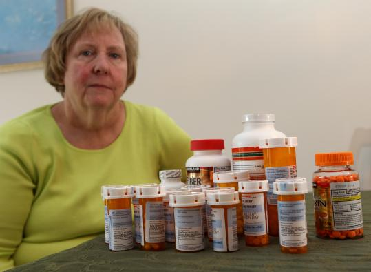 Pat Liberti saw significant savings on her prescription drugs under the federal health care law, which allows her to pay only half the cost of her supply of heart drugs.