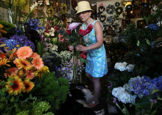 Nancy Mantilla says business has boomed at her Flores Mantilla flower shop in Marblehead since a movie crew arrived.