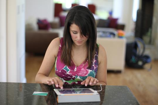 Kelly Tharp of Cohasset prefers her iPad for shopping over other devices or in-store buying.