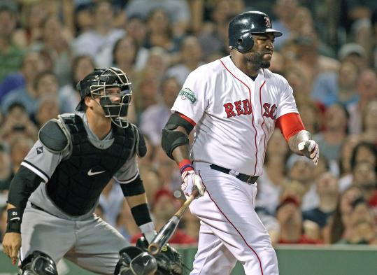 David Ortiz works an eighth-inning walk Monday; he hurt his Ac