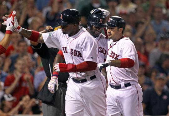 Carl Crawford led the celebration after scoring with an injured David Ortiz (center) on Adrian Gonzalez&#8217;s homer.