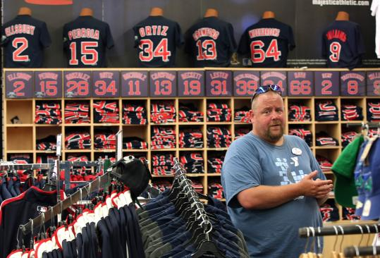 Chris Webster of Hookset, N.H., looked over a huge selection of Boston Red Sox shirts one day recently at the Yawkey Way Store.