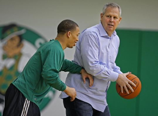 Tyronn Lue (left, with Celtics president Danny Ainge) no longer thinks of himself as a player, but rather a coach.
