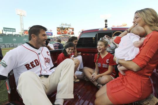 Retired Red Sox catcher Jason Varitek and his wife and daughters ride in the bed of the new truck given to him by the organization in a pregame ceremony honoring his career.