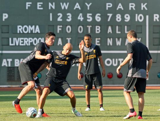 The Green Monster may seem a strange fixture, but Liverpool FC players should feel right at home playing in the stadium of their sister club.
