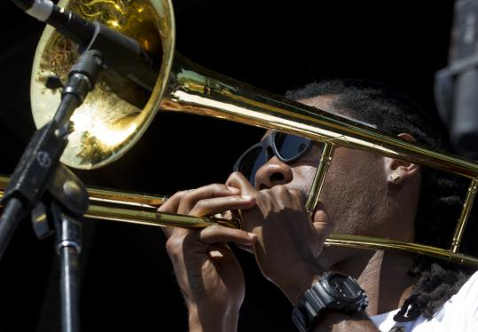 Corey Peyton (pictured in Manchester, Tenn., in June) and the Soul Rebels played to the end of a rainy Saturday concert.