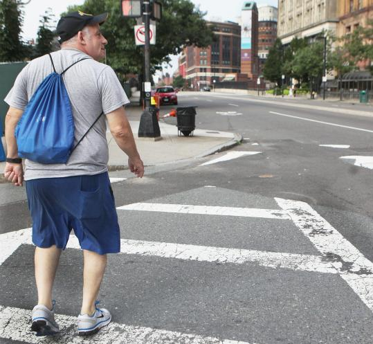 Retiree James Spriggs, 65, likes that he can walk just about anywhere he wants to go from his South End home.
