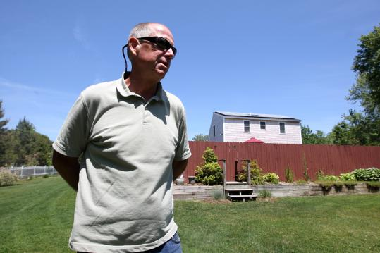 Mark Donahue had solar panels installed on the roof of his Plymouth home through a lease program with SolarCity.