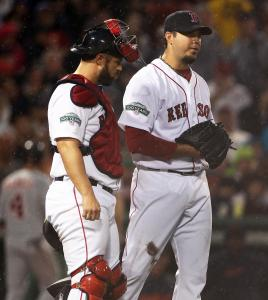 Sox starter Josh Beckett (right) summoned a trainer to the mound in the top of the third.