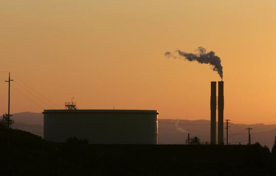 Elizabeth Warren and Scott Brown have differing views on greenhouse gases.