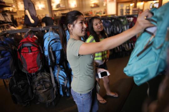 Joanne Ly, a Curry College student, and her sister Amy Ly, 11, searched for backpack at shopping at L.L. Bean in Dedham.