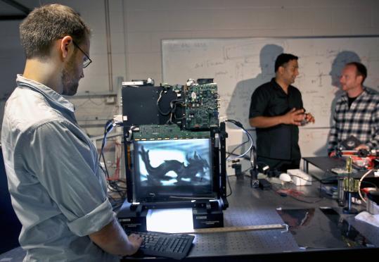 Matt Hirsch (foreground) with colleagues Ramesh Raskar and Gordon Wetzstein at the MIT Media Lab.