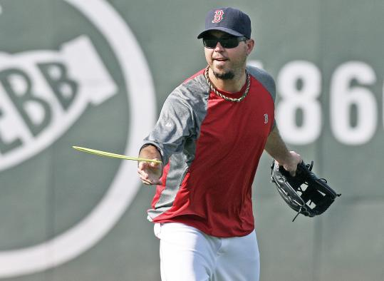 Josh Beckett got in a little extra throwing before Tuesday night's game, flipping a flying disk with some teammates.