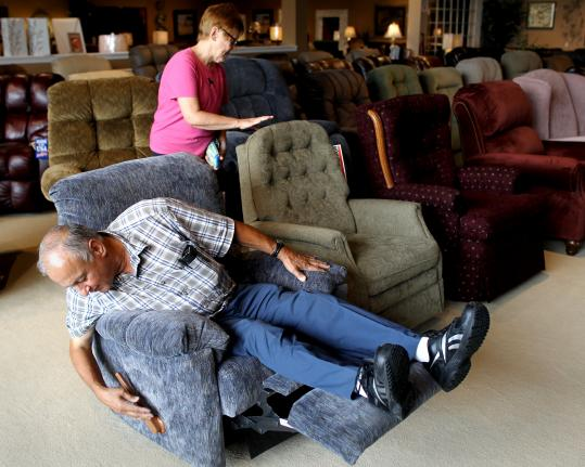 Vincent Carvelli checked out a recliner Friday at Bernie & Phyl&#8217;s in Braintree. The store has prepared for a busy weekend.