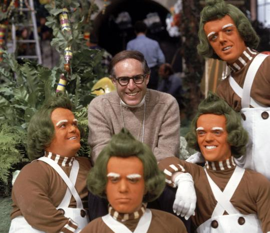 Mel Stuart posed with several Oompa Loompas for a publicity shot in the chocolate room.