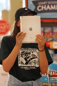 Cailin Currie used an iPad at a grocery to translate bar codes into product information.