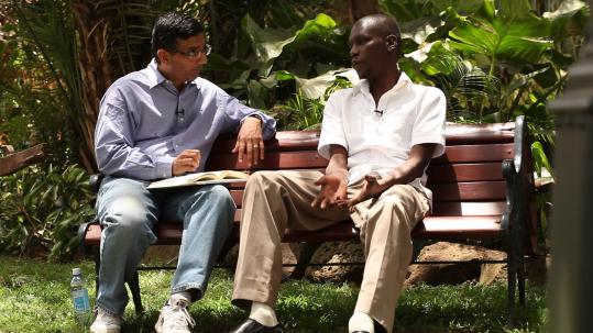 "Author Dinesh D'Souza (left) in-terviews George Obama in Kenya in ""2016: Obama's America."""