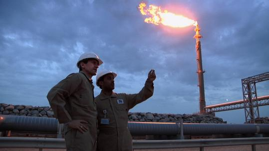 """Dr. Scott Tinker (left) and marine engineer Talal al Tamimi, on an LNG fueling dock in Qatar in the documentary """"Switch."""""""