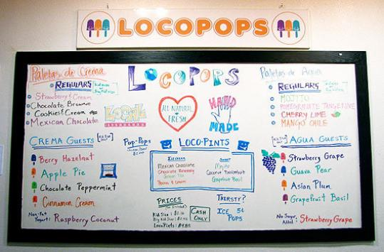 The whiteboard at Locopops' Chapel Hill location spells out the daily choices. The Mexican-style popsicles have become popular with all ages seeking relief from the North Carolina heat.