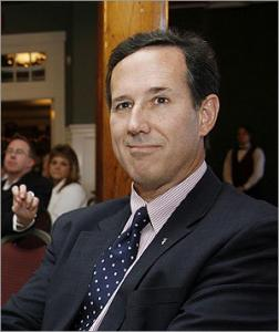 Former US Senator Rick Santorum, R-Pa., listened as he was introduced during a visit to the Manchester Rotary Luncheon in Manchester, N.H. Santorum has said the founder of WikiLeaks could be prosecuted as a terrorist for releasing classified information.