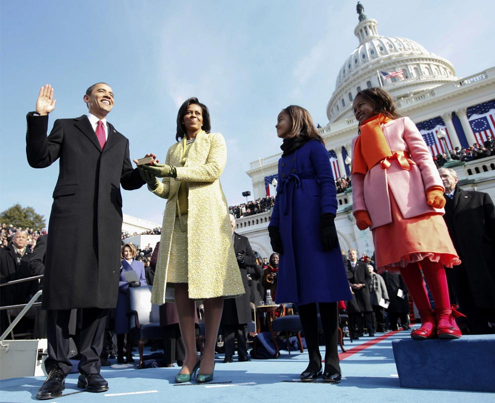 Barack H. Obama is sworn in as the 44th president of the United States as his wife Michelle Obama holds the Bible and their daughters Malia Obama and Sasha Obama look on, on the West Front of the Capitol January 20, 2009 in Washington, DC. (Chuck Kennedy-Pool/Getty Images) #