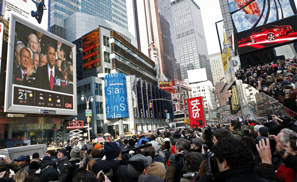 Spectators in Times Square watch President Barack Obama take the oath of office during his inauguration Tuesday, Jan. 20, 2009 in New York. (AP Photo/Jason DeCrow) #