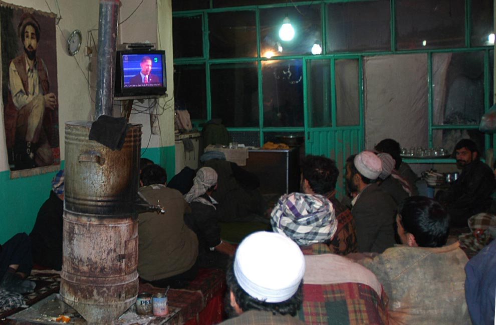 Afghan men watch a television broadcast showing the inauguration of Barack Obama as the 44th president of the United States, at a restaurant in Kabul, Afghanistan, Tuesday, Jan 20, 2009. (AP Photo/Ahmad Masoud)