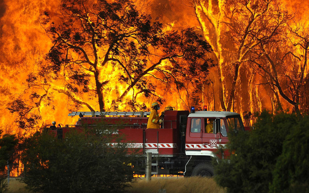 Walls of flame roared across southeastern Australia, razing scores